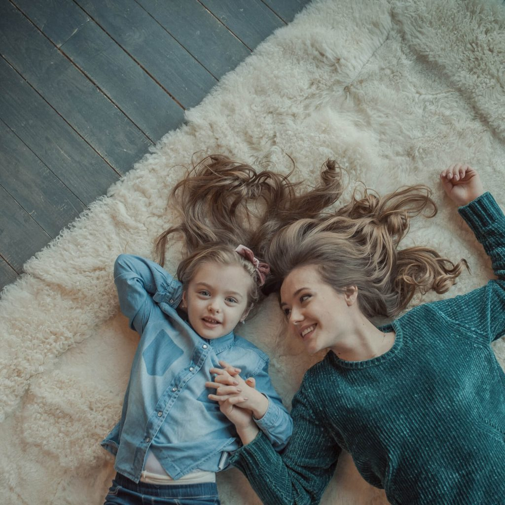 Kid with mom on Carpet | Independent Floor Covering