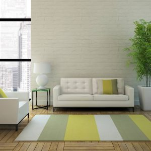 White sofa with area rug | Independent Floor Covering