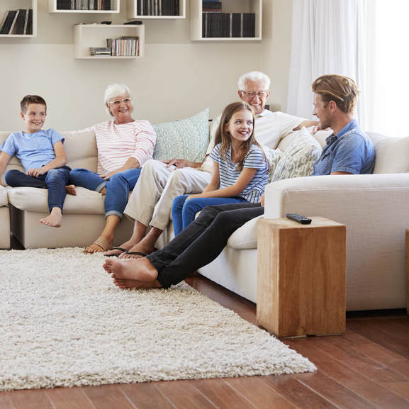 Family gosping in living room | Independent Floor Covering
