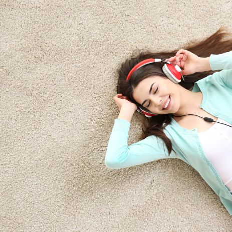 Girl listening music on Carpet | Independent Floor Covering