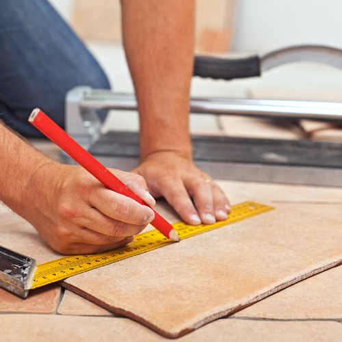 man installing tile flooring | Independent Floor Covering